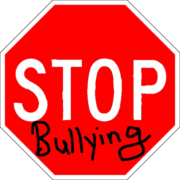 acosoThe_image_is_a_stop_sign_with_the_words_stop_bullying_2014-02-18_21-03